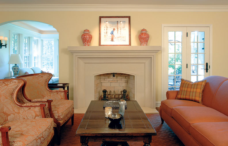 A clean-lined limestone mantel replaced the old plaster-and-brick version. To the right of the fireplace, a new set of doors allows the family easy access to a dining table on the terrace when the weather is warm.