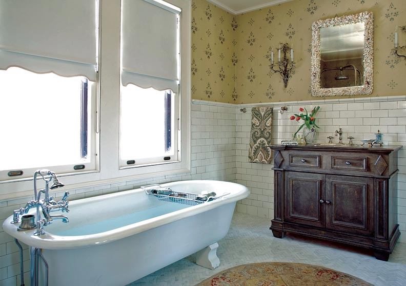 The master bath's 1970s-era palm-fronds mural was replaced with a more soothing, and era-appropriate, wallpaper.