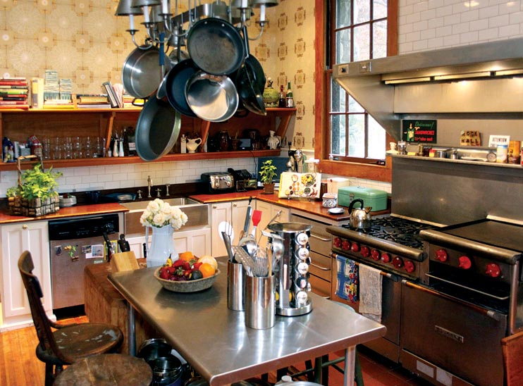 In the kitchen, the basic layout remains the same, but the shelving is new—re-created from examples in the butler's pantry.