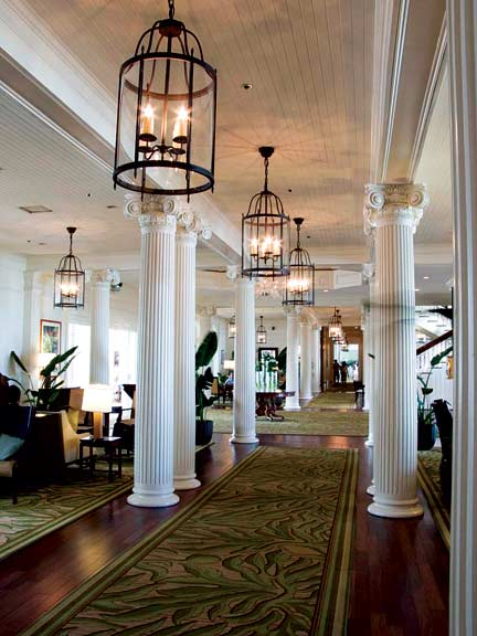The lobby, lined in restored Ionic columns, has French doors along both sides; kept open, they usher relaxing breezes across the main floor.