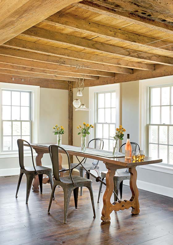 An exposed ceiling in the dining area offers a rustic touch. A contemporary light fixture offers a touch of modernity.