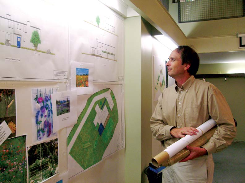 Mike Rhines examines sketches and planting samples.