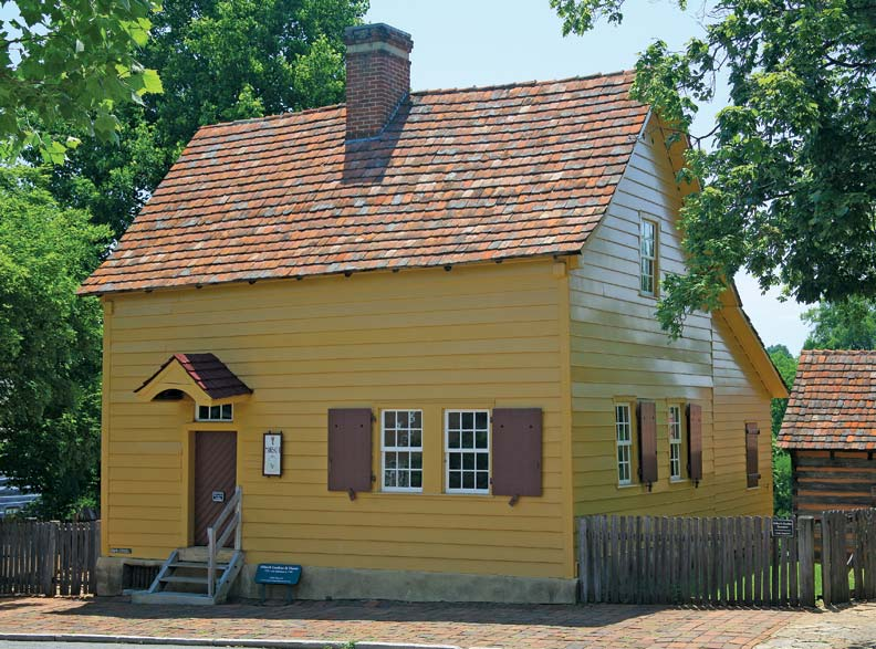 The log Miksch House was covered in clapboards and painted yellow soon after its construction in 1771; like all early Salem houses, it was roofed in tiles made in the village.