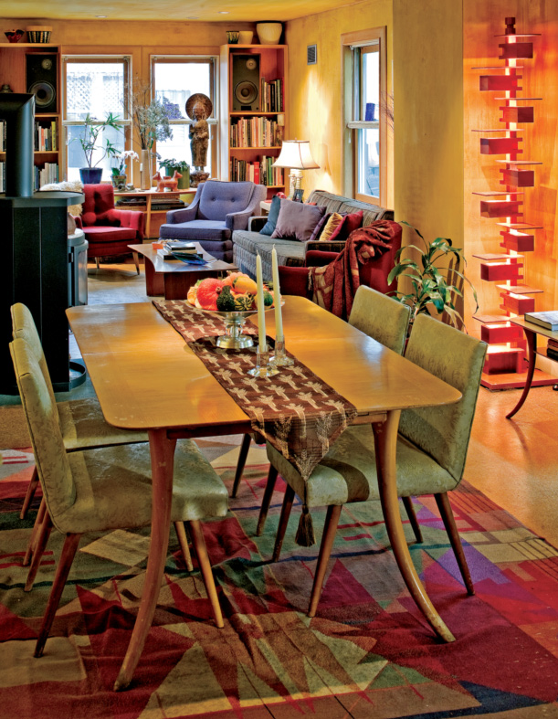 An open floorplan makes the small house seem larger. Adjoining areas are unified by white-oak woodwork and hand-stained ochre plaster. An important Klismos dining-room ensemle is a centerpiece; the needlepoint rug is by the painter Tim Van Campen, for Michaelian & Kohlberg.