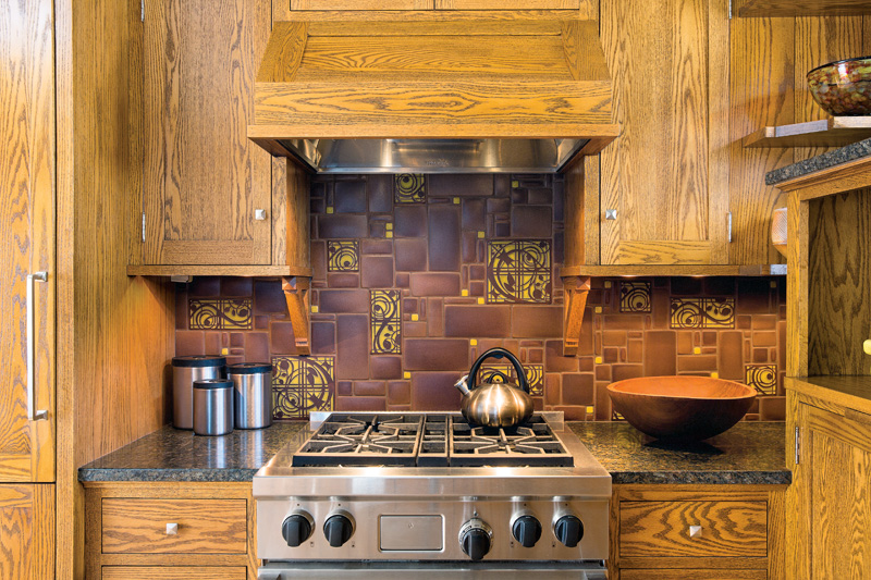 Motawi art tile is featured on the stove wall.