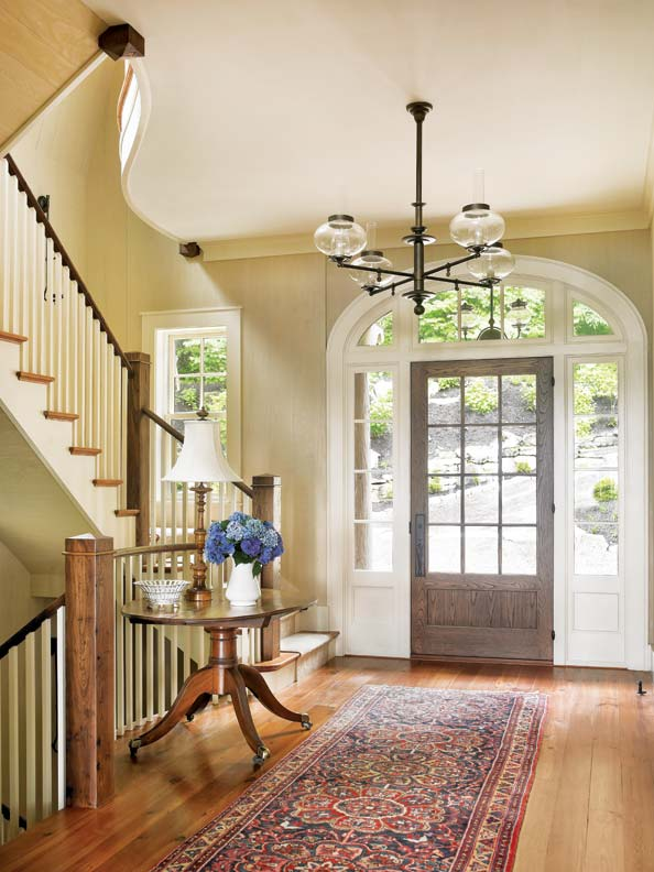 The light-filled entry hall is warm and welcoming.