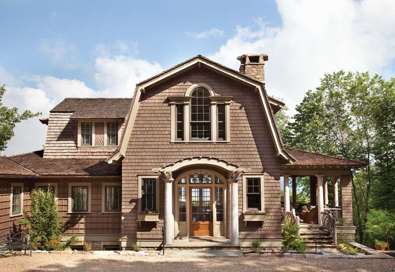 The architectural firm married classical detailing and vernacular style with this mountain-high retreat. Greek Doric columns are made from hand-hewn timbers. The elliptical shape of the portico and the rounded purlins set the tone for softer, more fluid detailing inside.