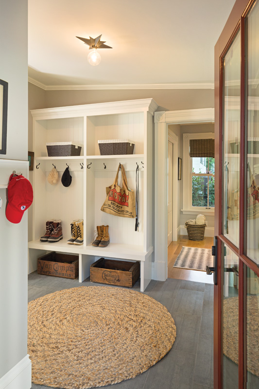 The mudroom is situated in the other addition, along with the master suite, and fills part of the flat-ceilinged connector area that joins the addition to the historic home.