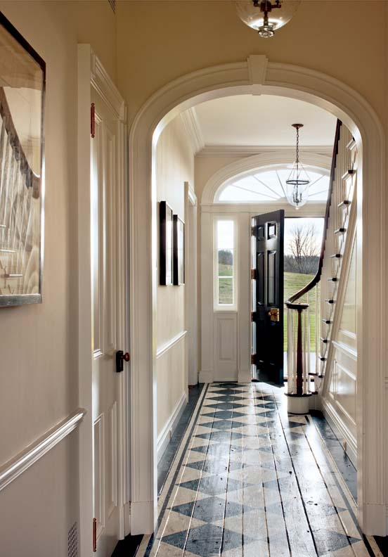 Classical moldings and a painted floor add authenticity.