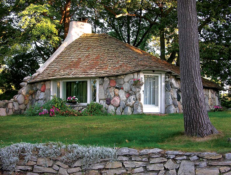 The Half House is Young's smallest creation. Composed almost entirely of granite boulders and local fieldstone, the cottage appears to have sprung up from the ground.