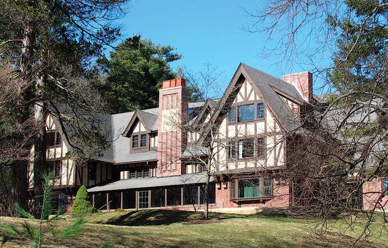 The impressive 1906 Tudor Higginson Estate now houses the Thoreau Society.