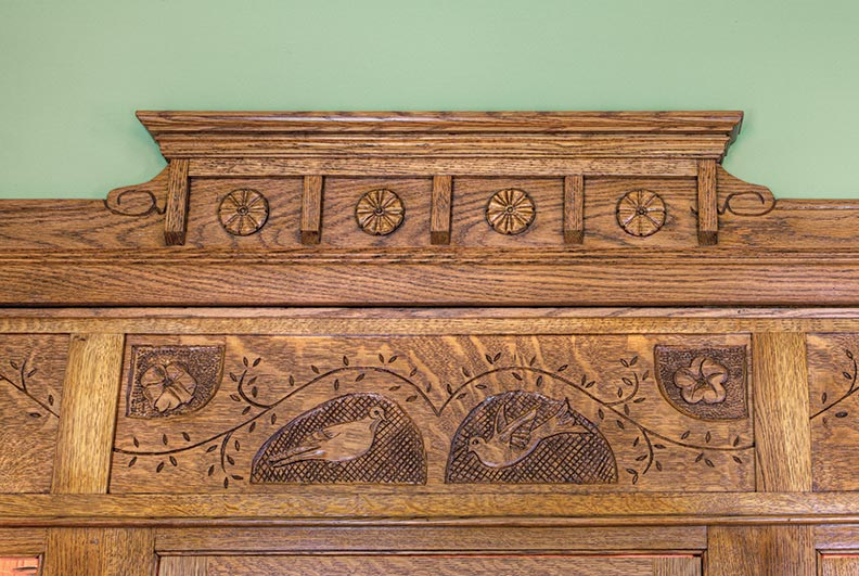 The carved design in the three-panel frieze was inspired by a pair of mourning doves that had nested in hanging baskets on the Harters' porch.