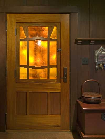 Nathan designed and built the front door, which features a panel of Kokomo seeded glass.