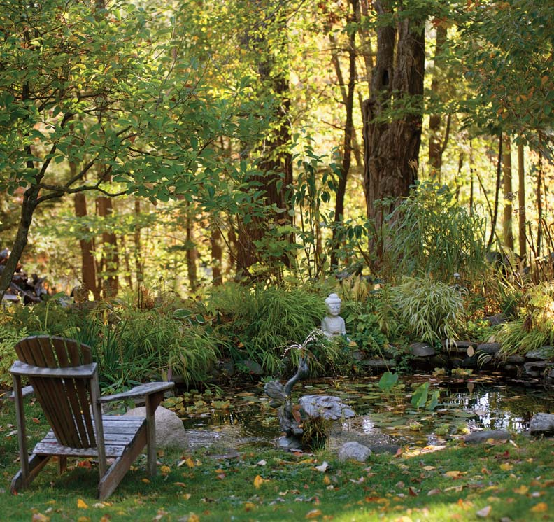 "The couple rented an excavator to create the woodland pond, where lilies overwinter: It's 3' deep with 18""-deep ledges along the edge."