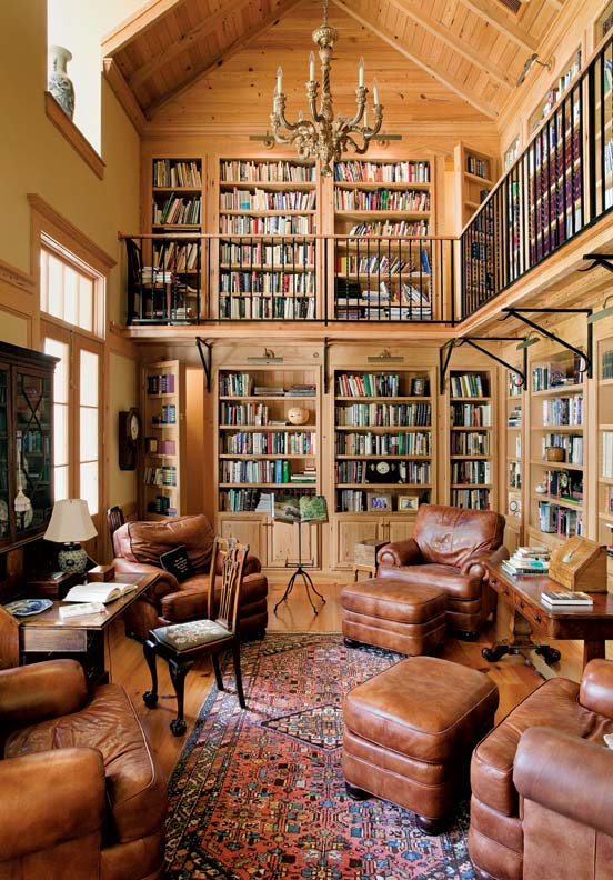 The two-story library holds the couple's extensive collection of books. Note the secret doors in the stacks.