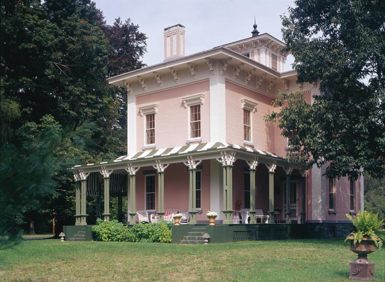 In keeping with the house's other Regency colors, the columns on the front porch were painted to resemble verdigris.