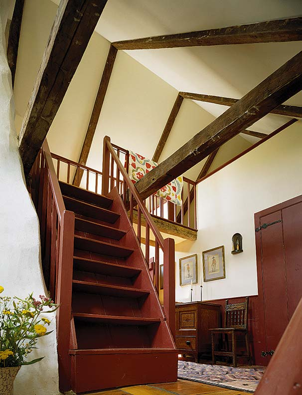 A simple painted staircase leads to the second floor.