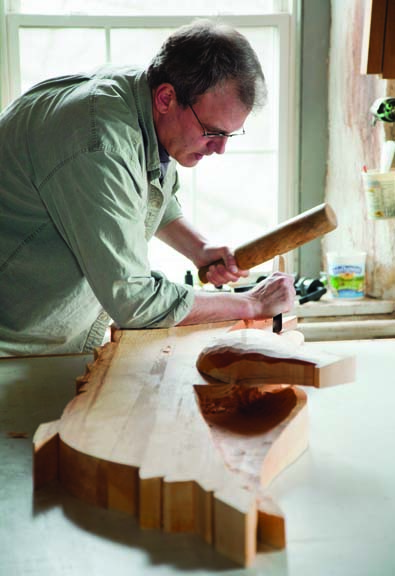 Woodcarver Eric Bogdahn creates works of art in his Rhode Island studio.