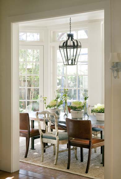 A sun porch doubles as a dining room in the Santa Monica house.