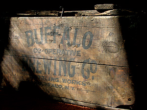 At our first auction, my husband spotted a crate from the defunct Buffalo Co-Operative Brewing Company (1880 to 1920). We got it for a song ($15), and it's the perfect size to store chargers and cords for our electronic equipment.