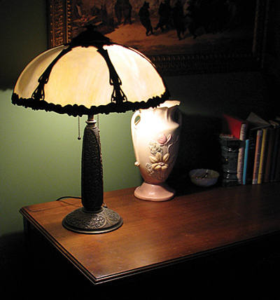 We wanted a slag-glass lamp forever, but in antique lamp stores they were always $500 to $1,000, way out of our price range. This one, which we got for $80, has one chipped glass panel, easily hidden by turning it to the wall. It's a beautiful shape: elegantly Victorian, as opposed to overwrought.