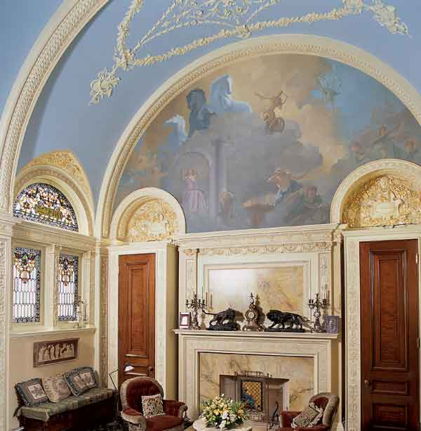 In an 1871 Boston house, the music room is neoclassical with an original plaster ceiling and a newly painted mural of Apollo. (Photo: Eric Roth)