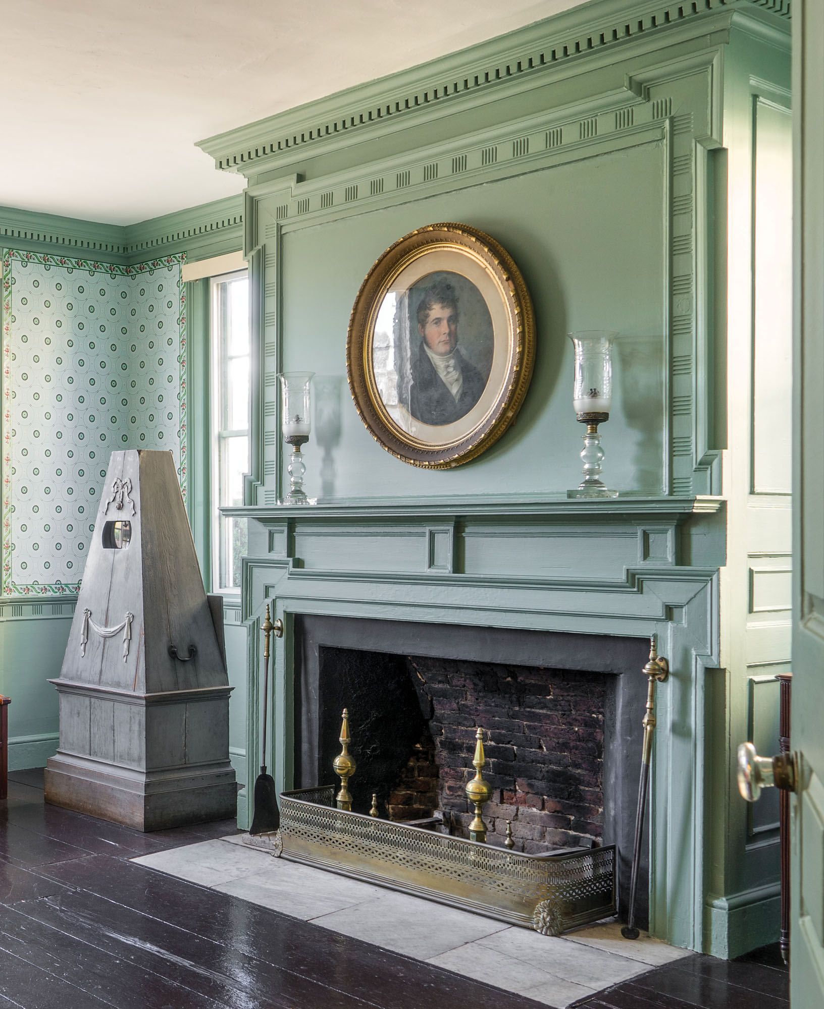 Mantelpieces culminate in this example in the green front parlor. It features Georgian eared mouldings and deep dentils in the cornice.