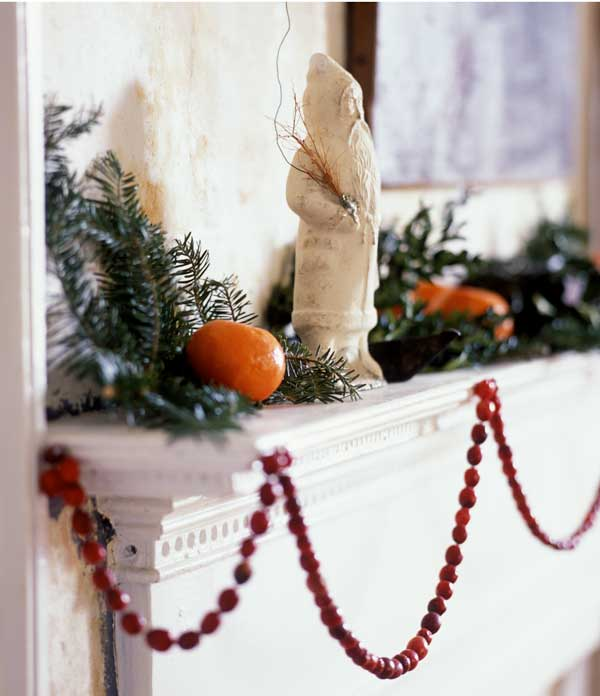 Old-fashioned and modern at once, this spare decorating is typical of old New England homes. The red of the cranberry garland is dramatic against the white-enameled mantel. (Photo: Kindra Clineff)