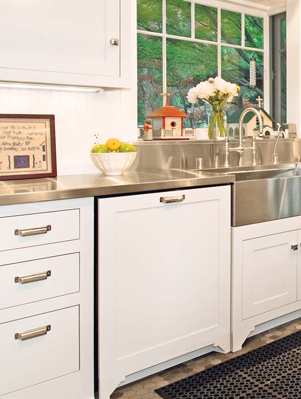 Minimize the impact of a built-in dishwasher by hiding it behind a panel matching the rest of the cabinets.