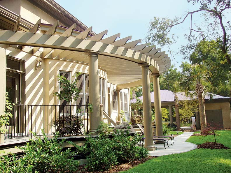 "A ""true pergola"" attached to the house is carried by one row of columns in design #1018 from Chadsworth Columns."