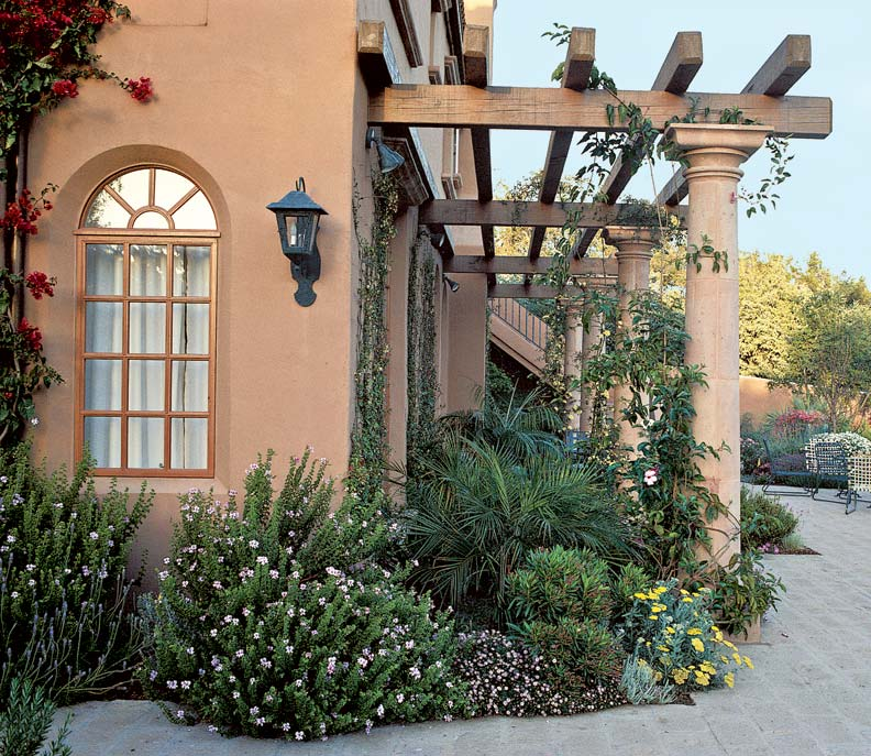 A simple pergola enhances a masonry house in Santa Barbara.