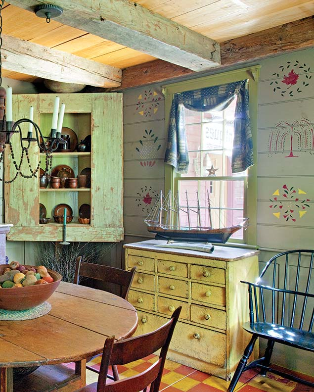 Stencil-painted motifs on board walls in the manner of the late 18th century, in a replica gambrel house in Maine.