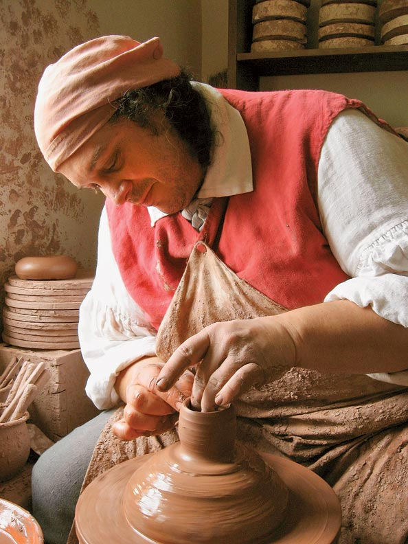 Hands-on demonstrations like pottery turning are daily rituals.