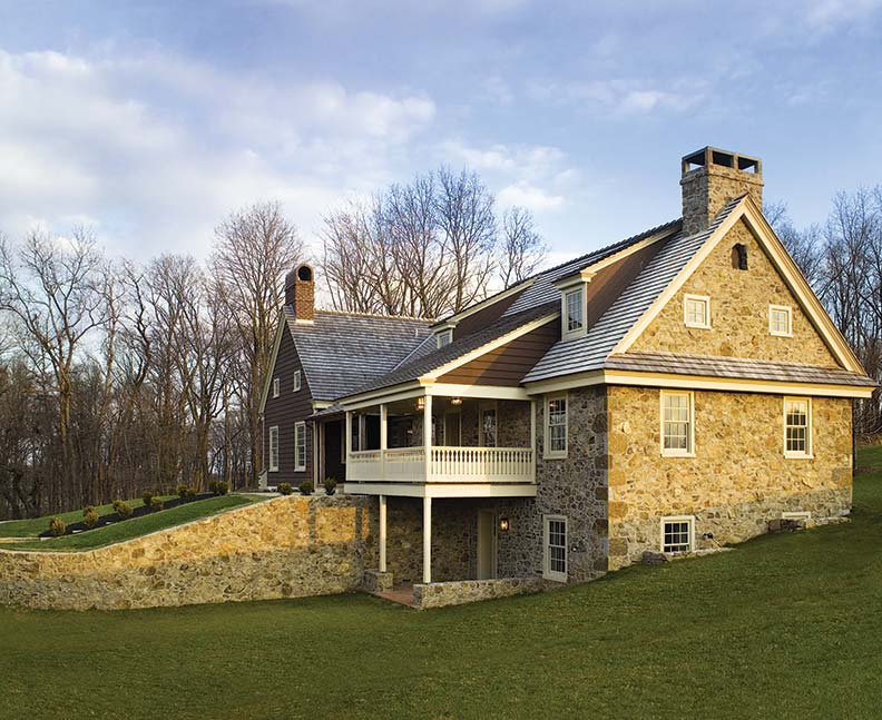 Complete with a berm and nestled into its sloping site, the Brown House mirrors 18th-century Chester County homesteads that were added to over time. Mixed materials were used in constructing stone, log, and wood-framed sections.