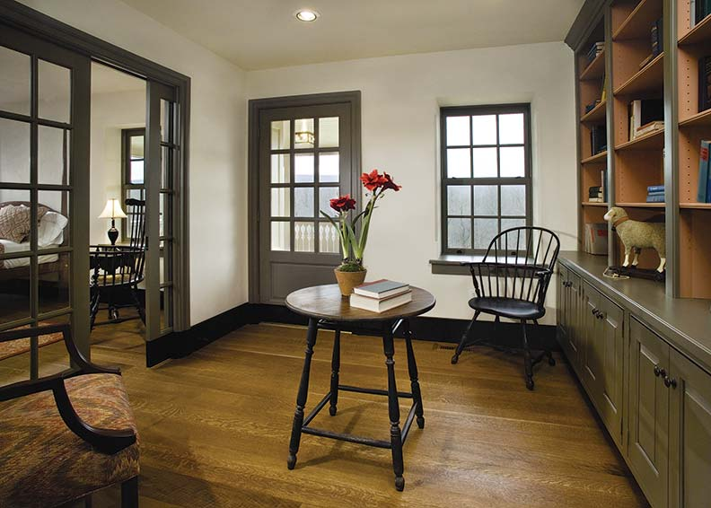 "Refined craftsmanship is evident in the Brown House sitting room with its French doors and built-in bookcases. Floors are quarter-sawn oak with a hand-rubbed, tung oil finish. Windows have 16""-deep sills and wells have chamfered corners."