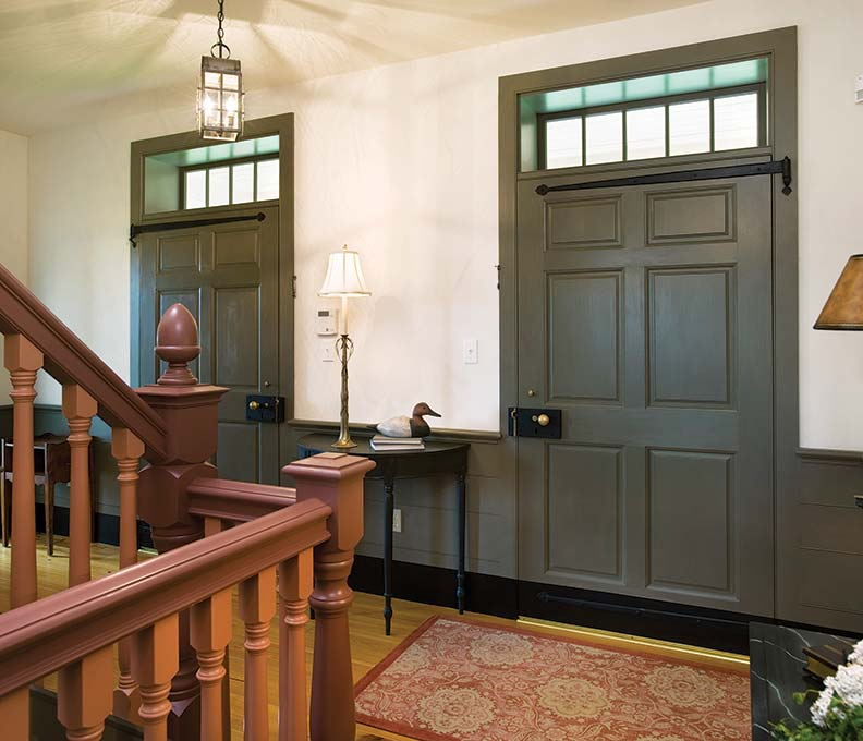 Interior details at Pleasantview reflect traditional housebuilding, from the solid, extra-wide paneled doors and board wainscot to the turned balusters and acorn finials on the Georgian-inspired staircase. Even the hardware is authentic to the period.