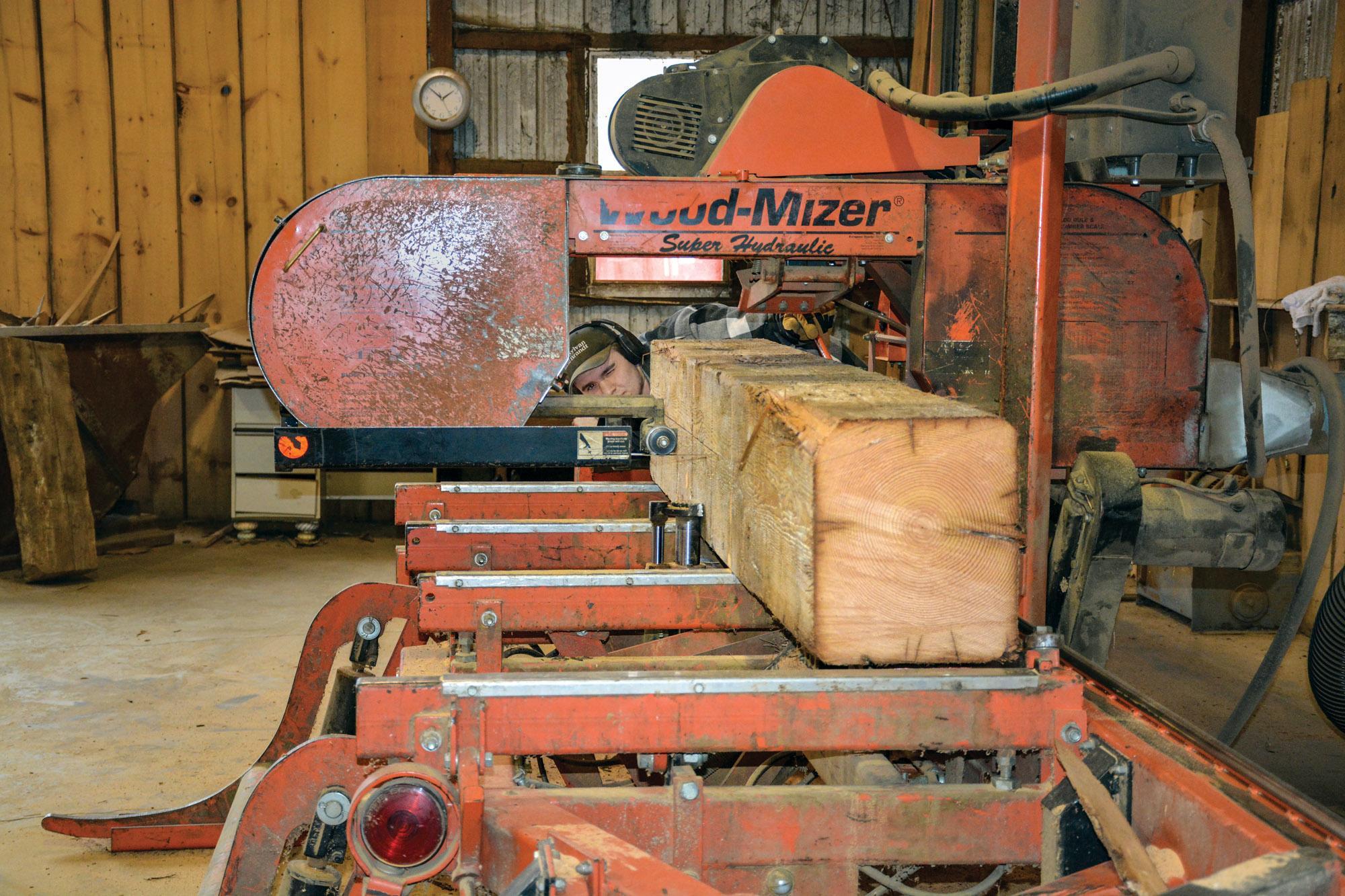 saw cutting through wood beam