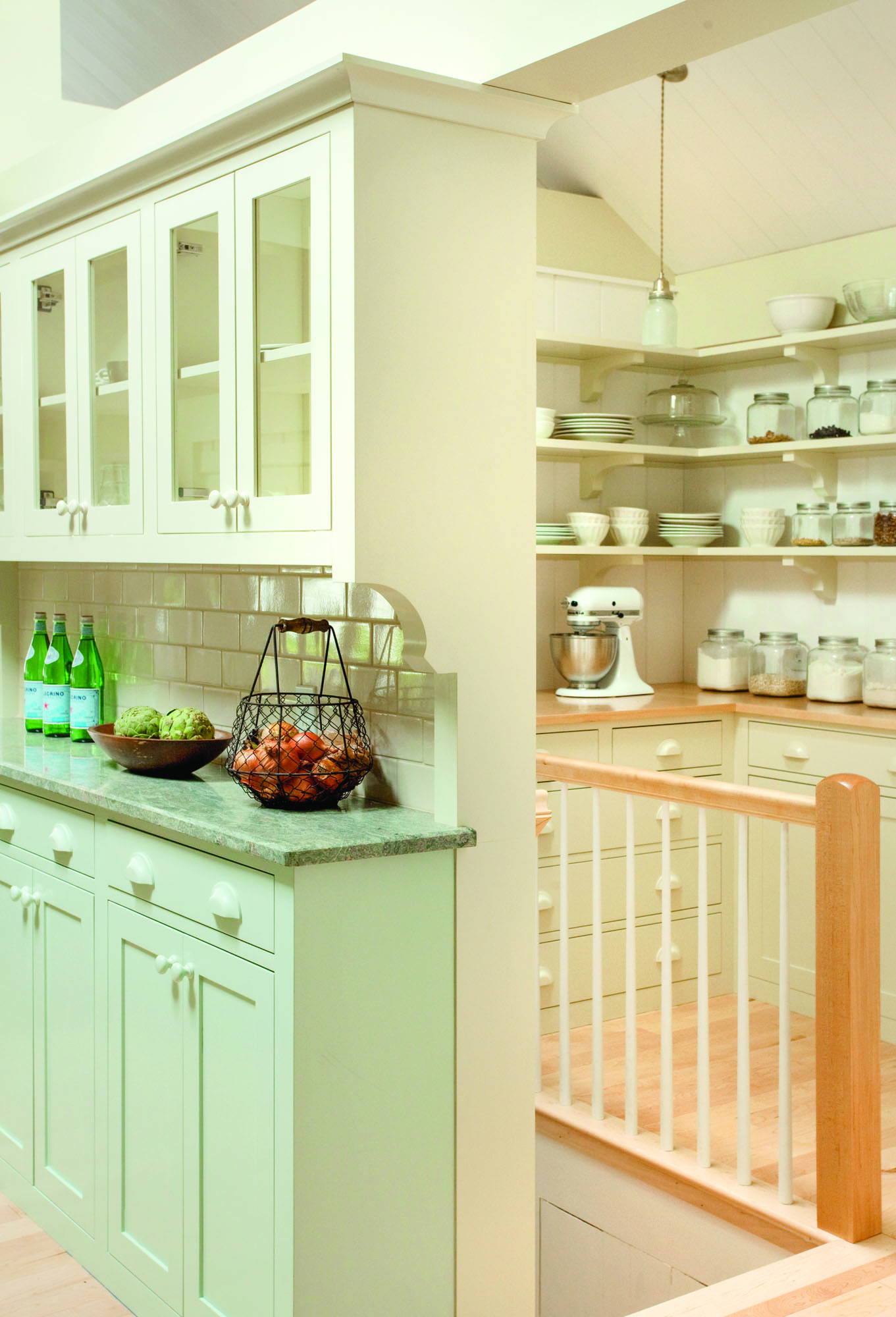 A farmhouse pantry tucks behind the kitchen; the stairway leads down to a new laundry room.