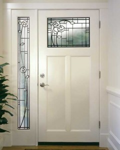 "Does your décor include motifs in the style of Charles Rennie Mackintosh? Even a simple ""Shaker""-style ""T"" door, like this one from Simpson Door, can be dressed up with leaded glass to coordinate."