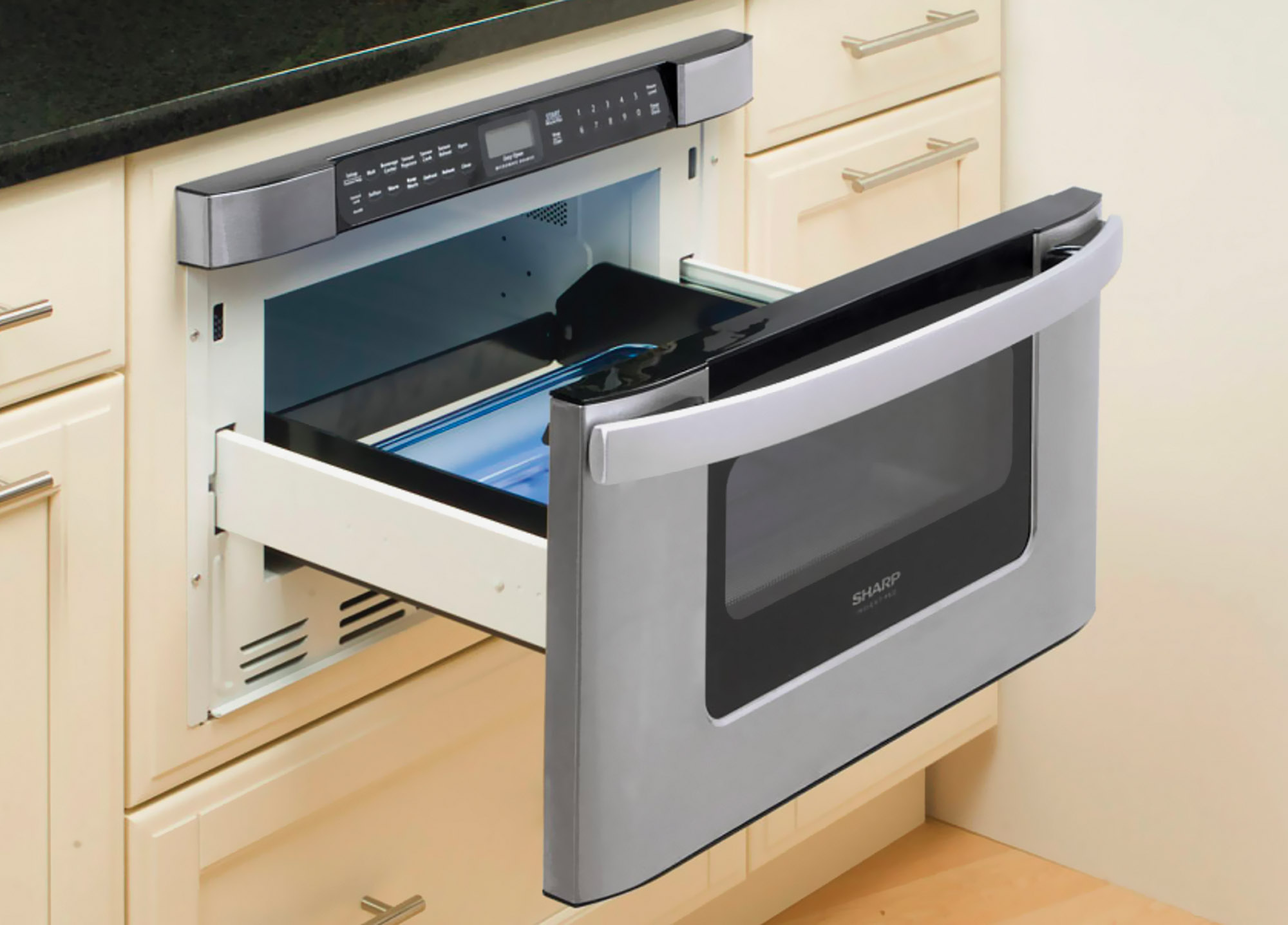 "Pullout microwave ovens open with a touch and are easy to use; this 24"" model is by Sharp."