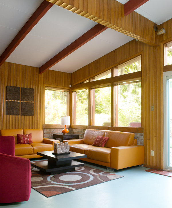 Orange sofas beckon in the main seating area at one end of the open-plan house.