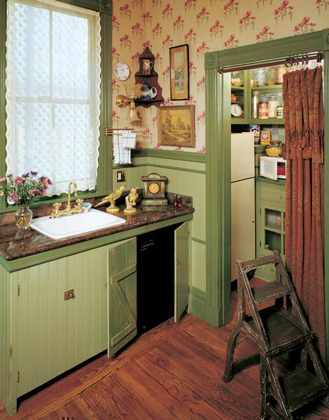 Original layout and vintage pieces paired with reproduction wallpaper. Photo: Linda Svendsen.