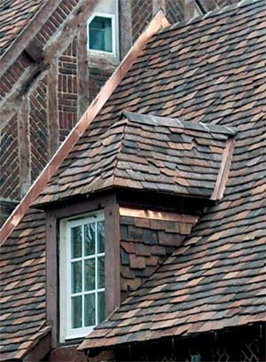 A blend of tiles from Tile Roofs Inc. covers an old house in Lake Forest, Illinois.