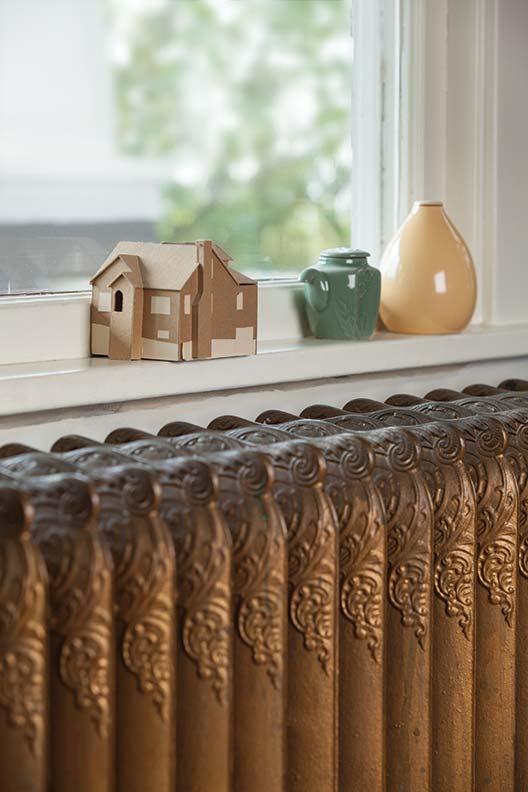 Ornate cast iron radiators are still in service.