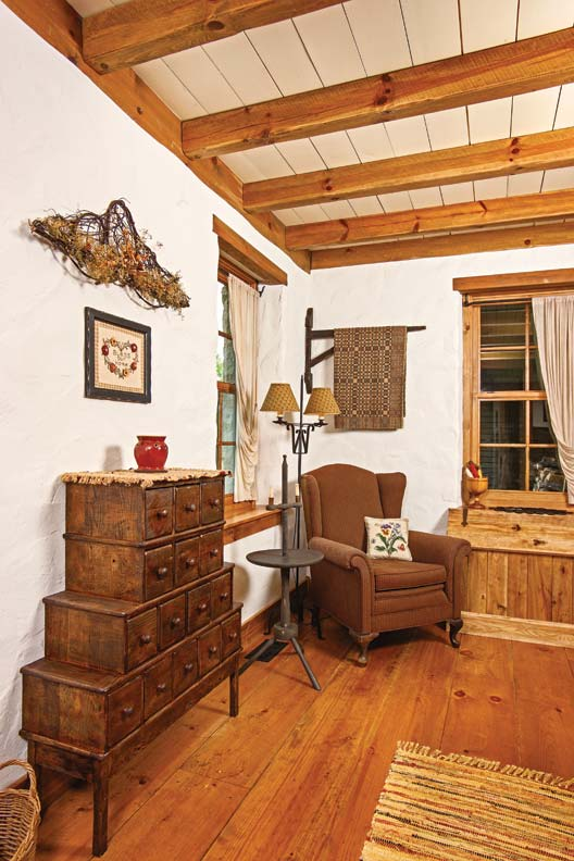 Owner-built furniture and authentic reproductions furnish the parlor.