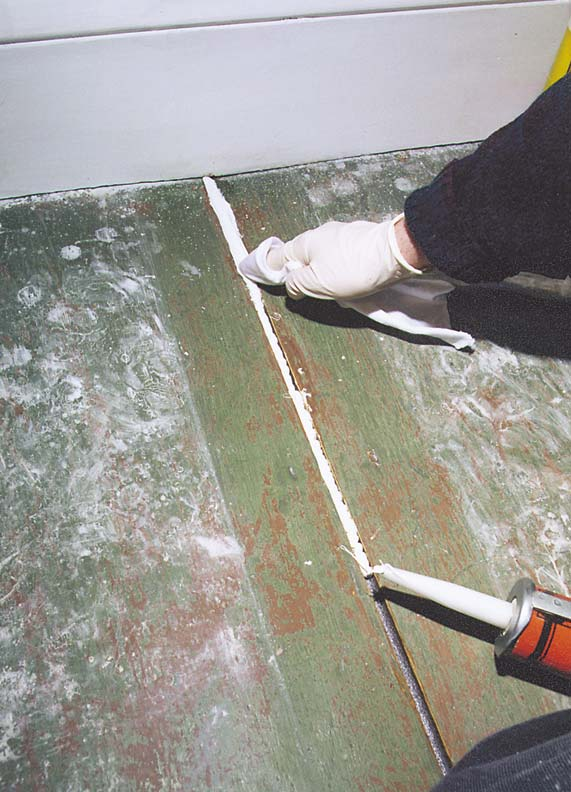 Paint Thinner Soaked Rag Restoring Painted Wood Floors
