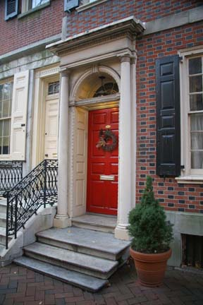 The entrance to the 1790 Pancoast-Lewis-Wharton House is enriched with a Tuscan frontispiece. A King of Prussia marble stoop and Flemish bond brickwork with glazed headers are both typical of the period.