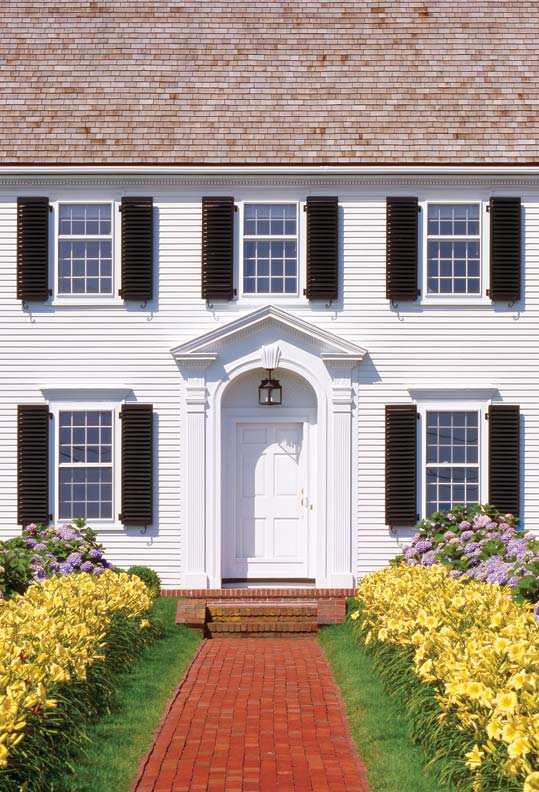 Six-panel doors are common on Federal, Georgian, and Colonial Revival houses, such as this 1938 Colonial Revival on Cape Cod.