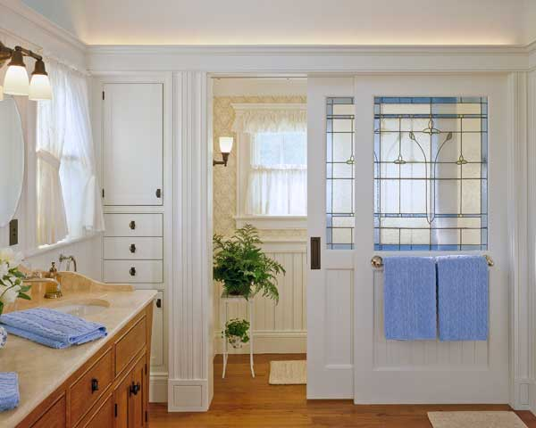Part of an expansion of a Shingle Style house on Cape Cod, this bath makeover created rooms within rooms with decorative sliding doors that don't block sunlight. Design by Hutker Architects. Photo: Brian Vanden Brink