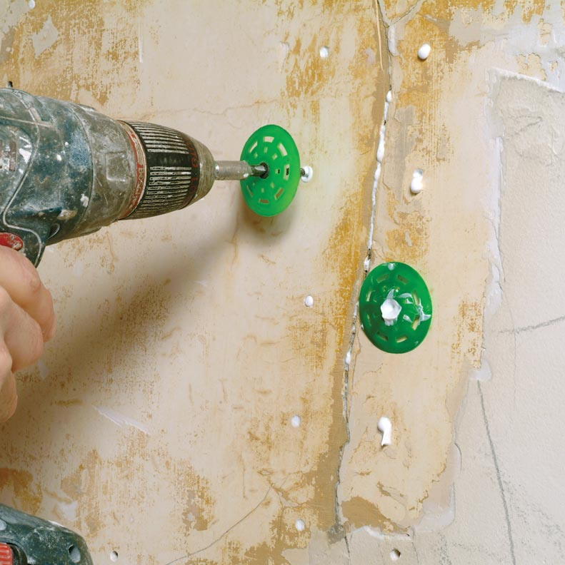 Use plaster washers to clamp the adhesive to the plaster